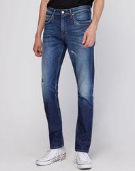 Jean slim Taper Campaign bleu - Calvin Klein - Modalova