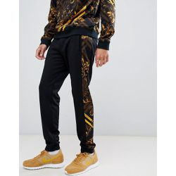 f4df7250b3b8 Pantalon de jogging skinny avec bande latérale motif baroque jaune - Versace  Jeans - Shopsquare