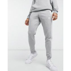 Adicolor - Jogger coupe skinny à trois bandes - chiné - adidas Originals - Modalova