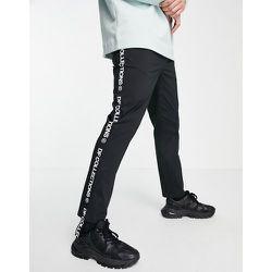 Pantalon slim longueur cheville à taille élastiquée et bande latérale - ASOS Dark Future - Modalova