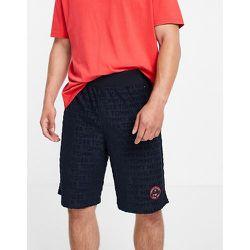 Short en tissu éponge avec petit logo tennis - Bleu - Tommy Hilfiger - Modalova