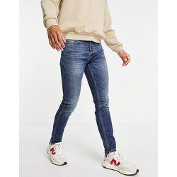Jean skinny stretch en coton biologique mélangé - Délavage teint moyen - Topman - Modalova